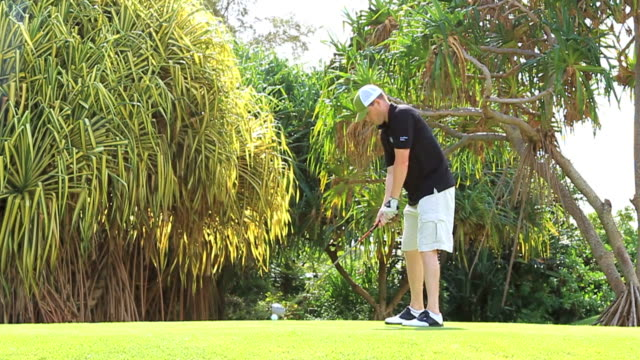 teeing off golf slow motion - teeing off stock videos & royalty-free footage