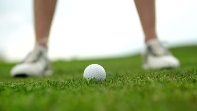 teeing the golf ball in slow motion - golf swing stock videos & royalty-free footage