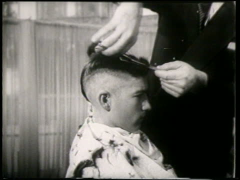 B/W 1951 PROFILE teen boy getting mohawk in barbershop / France / newsreel