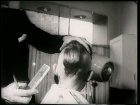 B/W 1951 REAR VIEW teen boy getting mohawk in barbershop / France / newsreel
