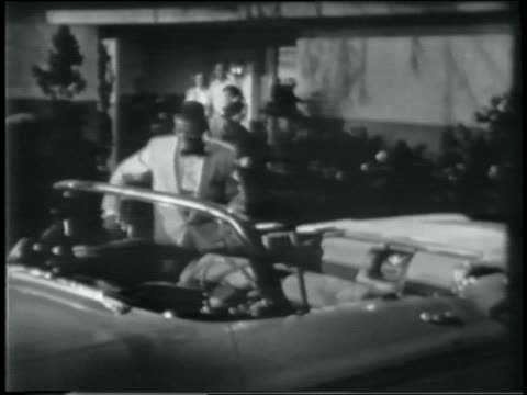 stockvideo's en b-roll-footage met b/w 1958 teen boy in formalwear getting into chevrolet impala convertible / family watches in background - alleen één tienerjongen