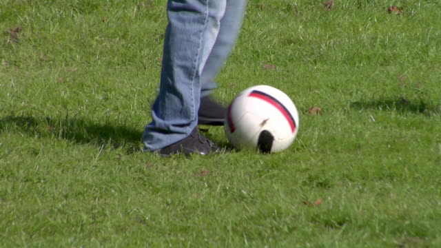 ms tu teen boy practicing soccer keep-ups in park / london, england - one teenage boy only stock videos & royalty-free footage