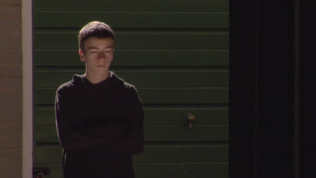 ms teen boy standing with his arms crossed / london, england - one teenage boy only stock videos & royalty-free footage