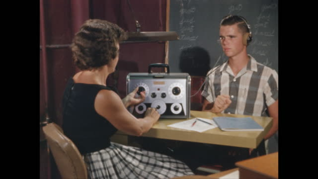 teen boy takes hearing test - one teenage boy only stock videos & royalty-free footage