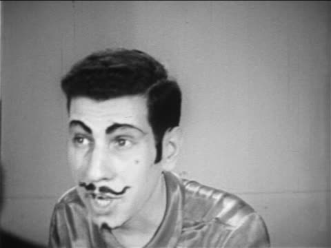 b/w 1949 teen boy with fake eyebrows + mustache talking / educational - one teenage boy only stock videos & royalty-free footage