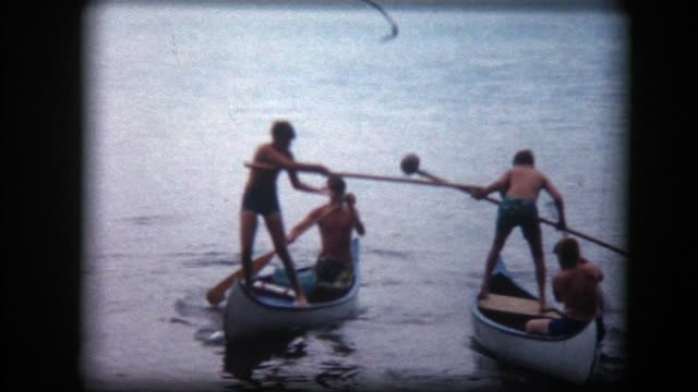 1966 teen boys have canoe battle - jousting stock videos and b-roll footage