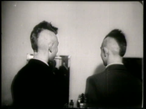 B/W 1951 REAR VIEW 2 teen boys with mohawks turning away from camera / France / newsreel