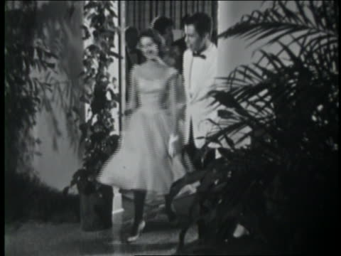 b/w 1961 teen couples arriving at prom in evening wear / coca-cola educational - evening wear stock videos & royalty-free footage