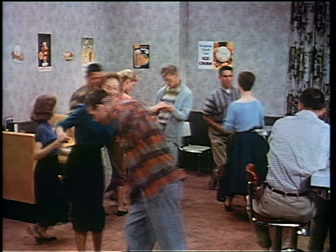 1956 teen couples dancing in soda fountain / San Francisco / educational