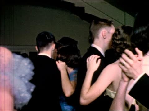 1953 teen couples in formalwear dancing / educational - 高校卒業ダンスパーティ点の映像素材/bロール