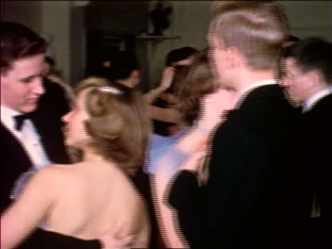 1953 teen couples in formalwear dancing / educational - 舞踏会点の映像素材/bロール