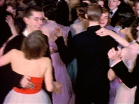 1953 teen couples in formalwear dancing / educational - cultura americana video stock e b–roll