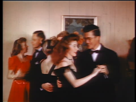 1945 teen couples in formalwear dancing / industrial - 舞踏会点の映像素材/bロール