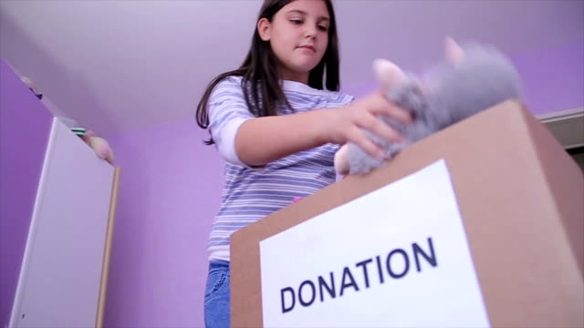 teen donates toys - charitable donation stock videos & royalty-free footage