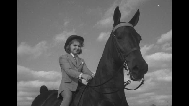 teen equestrienne joanne link rides her american saddlebred on a dirt track with white stable buildings in the distance this is probably robin hill... - dimple stock videos and b-roll footage