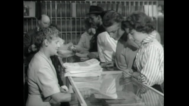 teen girl and boy listen to record in a music shop; 1955 - 1955 stock videos & royalty-free footage