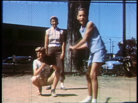 1957 teen girl batting hitting ball + running / educational - baseball bat stock videos & royalty-free footage
