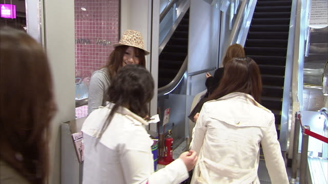ms teen girl distributing fliers outside clothing store, tokyo, japan - flyer leaflet stock videos and b-roll footage
