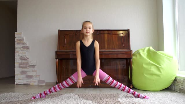 teen girl does some acrobatic [001] - acrobatic activity stock videos and b-roll footage