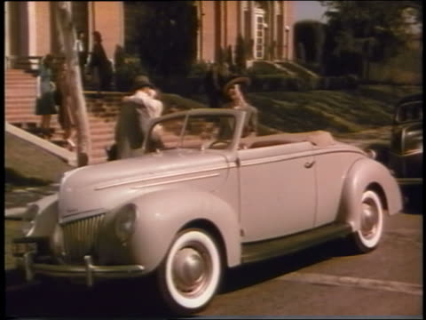 1939 teen girl hugs man by convertible ford then calls to other teen girls - 1939 stock videos and b-roll footage