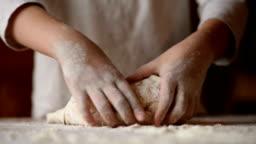 Teen girl kneads dough