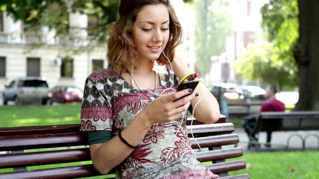 teen girl listening to music - park bench stock videos & royalty-free footage