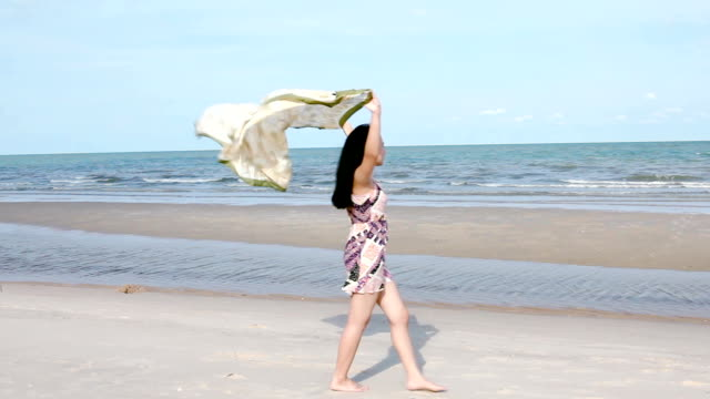teen girl on the shore beach. - sarong stock videos and b-roll footage