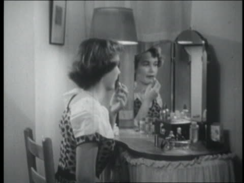 b/w 1954 teen girl putting on lipstick in mirror - lipstick stock videos & royalty-free footage