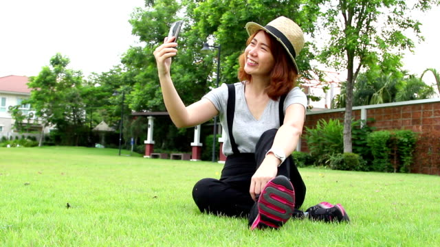 teen girl selfie with smartphone - showing off stock videos and b-roll footage