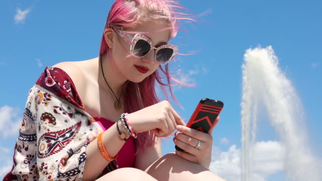 teen girl texting outdoors - pink hair stock videos & royalty-free footage