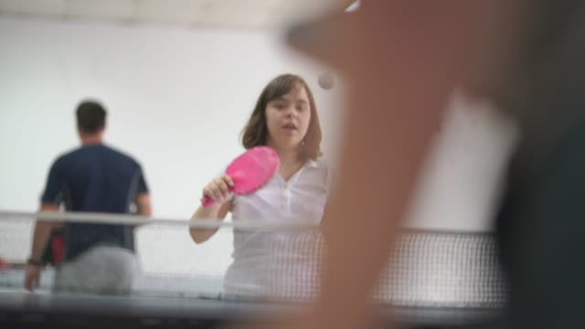 teen girl with down syndrome playing table tennis - persons with disabilities stock videos & royalty-free footage
