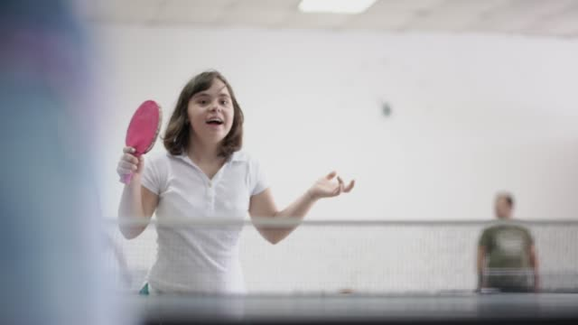 teen girl with down syndrome playing table tennis - equal opportunities stock videos & royalty-free footage