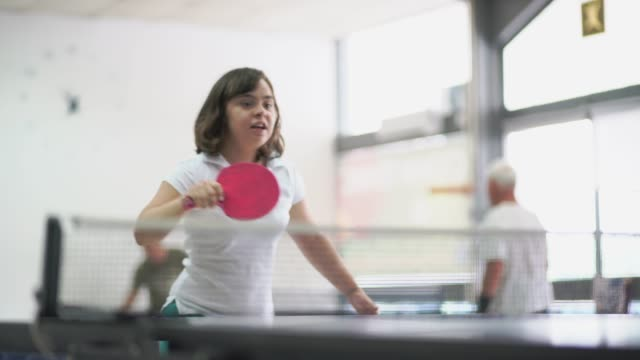 teen girl with down syndrome playing table tennis - 18 19 years stock videos & royalty-free footage