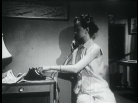 vídeos de stock, filmes e b-roll de b/w 1953 teen girl with hair in bobby pins making telephone call / jump cut - only teenage girls
