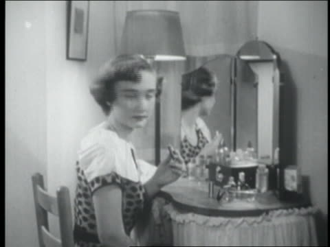 b/w 1954 teen girl with lipstick turning to mirror - 1954 stock videos & royalty-free footage