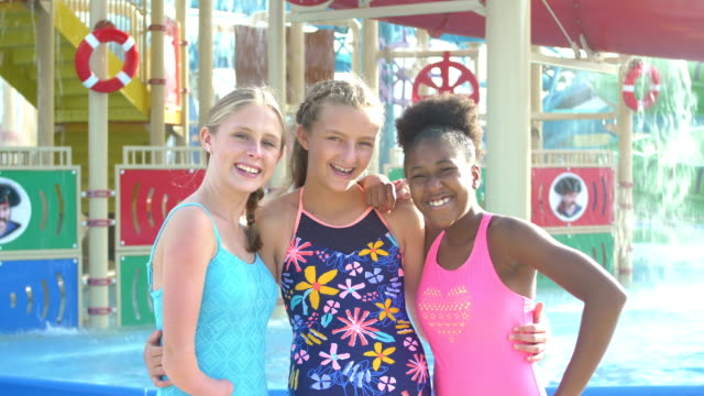 vídeos de stock e filmes b-roll de teen girl with malformed arm, friends at water park - 14 15 years