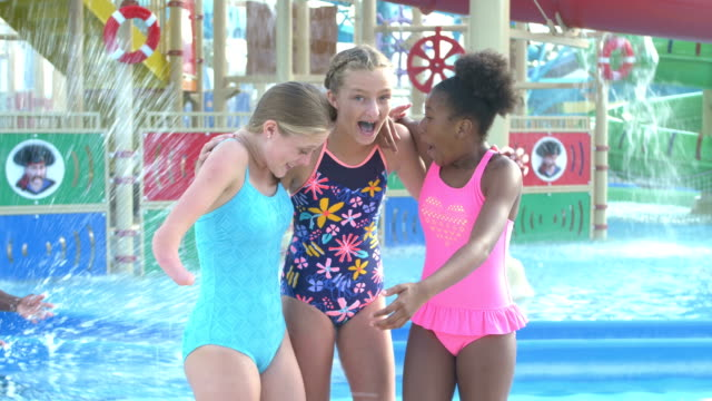teen girl with malformed arm, friends at water park - pre adolescent child stock videos & royalty-free footage