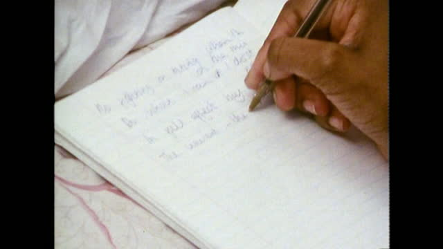 teen girl writes lyrics with a pen in notebook; 1989 - writing stock videos & royalty-free footage