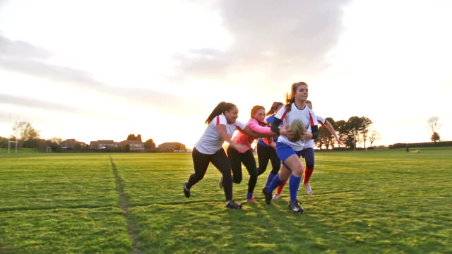 Teen Girls Playing Rugby on the Field