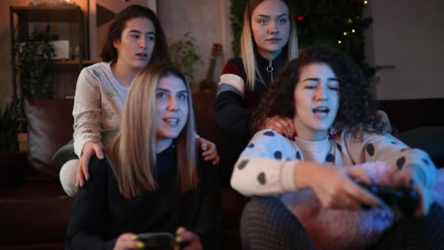 teen girls playing video games - slumber party stock videos & royalty-free footage
