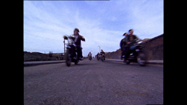teen hell's angels ride on motorcycles; 1969 - moving after stock videos & royalty-free footage
