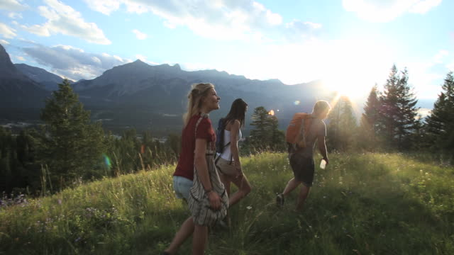 Teen hikers use map to determine route ahead