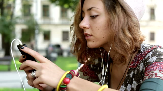 teen, listening to music - park bench stock videos & royalty-free footage