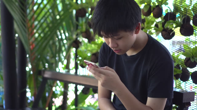 teen playing mobile. - lottery stock videos & royalty-free footage