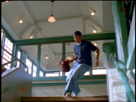 PAN teen purse snatcher running down flight of stairs in building