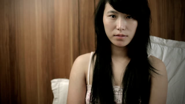 teenage asian girl looking at camera and thinking. - 18 19 years stock videos & royalty-free footage