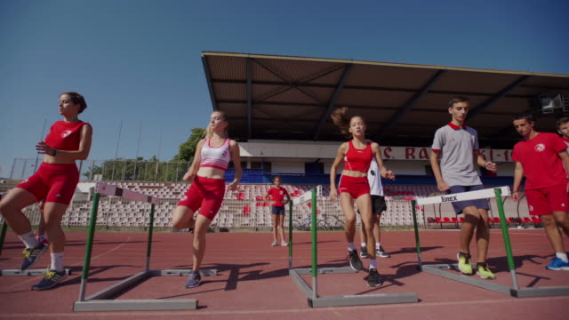 teenage athletes hurdling on training - athleticism stock videos & royalty-free footage
