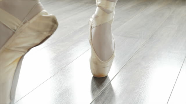 teenage ballerina dancing in her ballet shoes. - stand stock videos & royalty-free footage