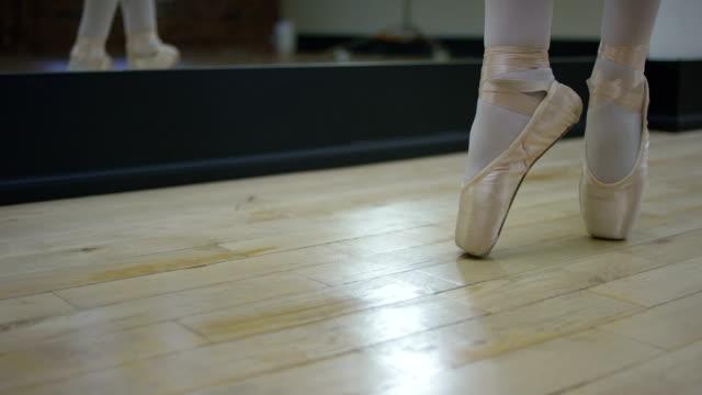 Teenage ballerina doing ballet