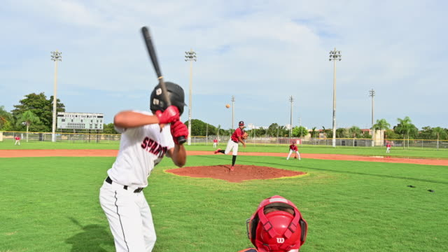 teenage baseball player at bat pops up for the out - sports equipment stock videos & royalty-free footage